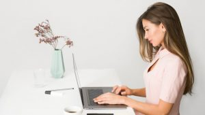 criteria or requirements of a good company secretary woman working with laptop